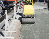Repair of asphalt pavement on the city road. Royalty Free Stock Photo