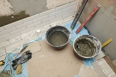 Repairs in the bathroom. Several rows of tiles are laid on the w Royalty Free Stock Image