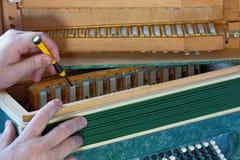 Repair of bayan. Repair of old musical instrument bayan royalty free stock photo