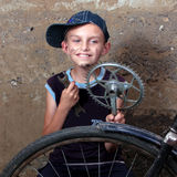 Repair of a bicycle. The boy repairs and old bikycle Stock Images