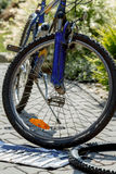 Repair of bicycle, prepare to change old tyre with tools Royalty Free Stock Photo