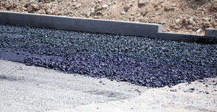 Repair of a black asphalt road as a background.  Stock Photo