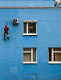 Repair of the blue wall. Painting of the wall in blue Stock Photo