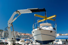 Repair of boat with blue sky. Repair of boat in Port Vieux - old port in Marseille Stock Photography
