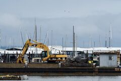 Repair Of Boat Dock WIth Heavy Machinery