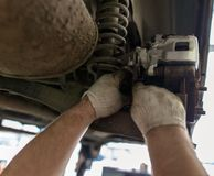 Repair of brake system on car wheels.  royalty free stock photography