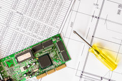 Repair broken computer, a chip with a screwdriver Royalty Free Stock Photography