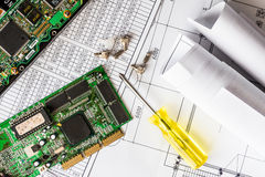 Repair broken computer, a chip with a screwdriver Stock Photo