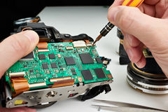 Repair broken DSLR camera service center Stock Images