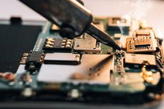Repair of a broken mobile phone. In the workshop stock photography