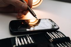 Repair of a broken mobile phone. In the workshop royalty free stock photography