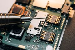 Repair of a broken mobile phone. In the workshop royalty free stock images