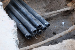 Repair the broken pipe with replace new. Black pipes stock photo