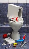 Repair broken toilet. The theme of the work, work royalty free stock photography