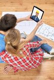 Couple having video call with builder royalty free stock photo