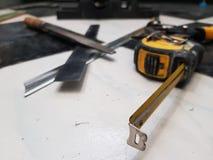 Repair - building with tools, tape measure, metal scissors, file, metal knife, pencil, knife, ruler royalty free stock image