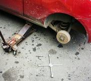 Repair car brake in garage Royalty Free Stock Photos