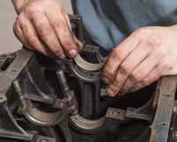 Repair car engine. Car mechanic repairing an internal combustion engine Stock Photo