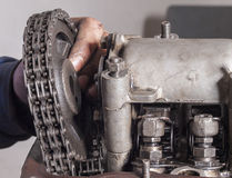 Repair car engine. Car mechanic repairing an internal combustion engine Stock Photos