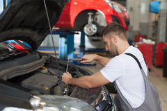 Repair The Car Engine with a Ratchet Wrench Royalty Free Stock Photos
