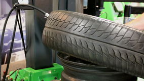 Repair and change of tires tyre. Tire tyre being mounted on a wheel at the service station by auto mechanic stock video