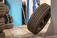 Repair and check car in repair shop. An experienced technician repairs the faulty part of the car. I change tires. Replacing winter tires on summer tires in a royalty free stock photos
