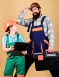 Repair. Children creativity. Bearded man with little girl. construction worker assistant. Builder or carpenter. Repair. Children creativity. Bearded men with stock image