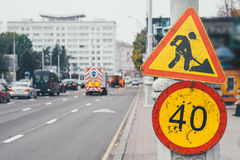 Repair city roads. Repair of urban roads with a speed limit restriction Royalty Free Stock Image