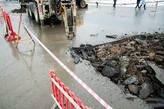 Repair of communications located under the carriageway. Road repair car breaks asphalt