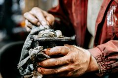 Repair constant-velocity joint in hands in garage, auto mechanic Stock Photo