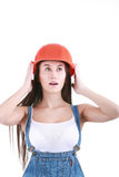 Repair, construction and maintenance concept - smiling woman in. Portrait of young female builder in helmet painting on white Royalty Free Stock Photo