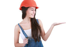 Repair, construction and maintenance concept - smiling woman in. Portrait of young female builder in helmet painting on white Stock Photography