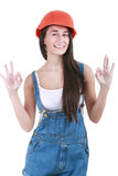 Repair, construction and maintenance concept - smiling woman in. Portrait of young female builder in helmet painting on white Stock Images