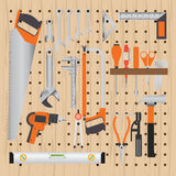 Repair and construction working tools on peg wooden background. Repair and construction working tools on peg wooden background, equipment flat design vecter Stock Photos