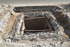 Repair cover drainpipe. Repair cover drainpipe on concrete pavement Stock Images