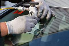 Repair crack in windshield Stock Photography