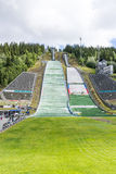 Repair crews are preparing for summer ski jumping competition on June 27, 2016 in Lillehammer, Norway Stock Photos