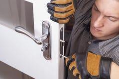 Repair door lock. Handyman repair the door lock in the room stock photography