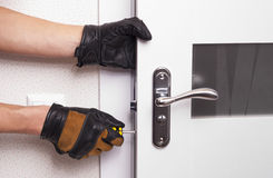 Repair door lock. Handyman repair the door lock in the room stock images