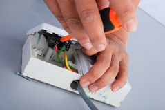 Repair of electric socket Stock Photography