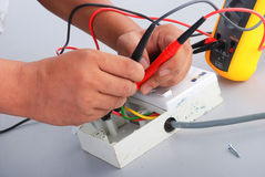 Repair of the electric socket Stock Photos