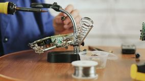 Repair of electrical equipment close-up. Man-an engineer repairing electrical equipment. The engineer considers the Board . A man soldering a circuit Board stock footage