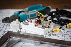 Repair of electronic appliance. Male repairman checking fridge with digital multimeter at home Royalty Free Stock Photos