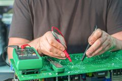 Repair electronic circuit backup power supply. Diagnosis and troubleshooting of the PCB.  stock photos
