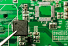 Repair electronic circuit board Royalty Free Stock Images