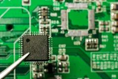 Repair electronic circuit board Royalty Free Stock Images