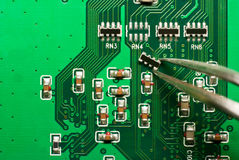 Repair electronic circuit board Royalty Free Stock Photography