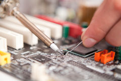 Repair electronic components. Reparation of electronic components on microchip Royalty Free Stock Photo