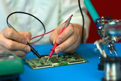 Repair of electronic devices. Measurements of electrical parameters by a multimeter. royalty free stock images