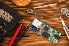Repair of electronic equipment repair kit, radio electronics concept. Set for soldering wire and shrink soldering tube with solder next to screwdriver and Royalty Free Stock Photo